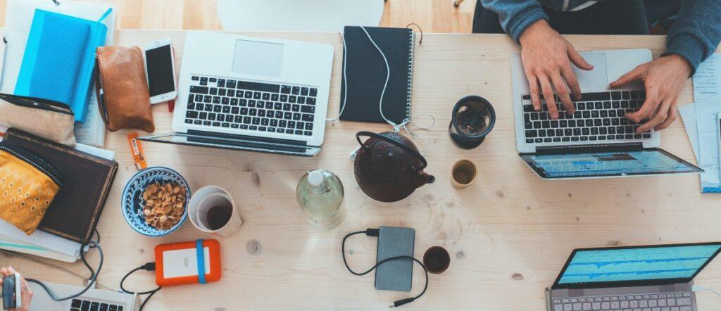 a desk full of laptops